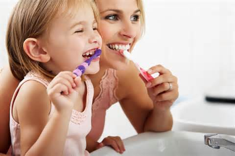 teach children to brush their teeth